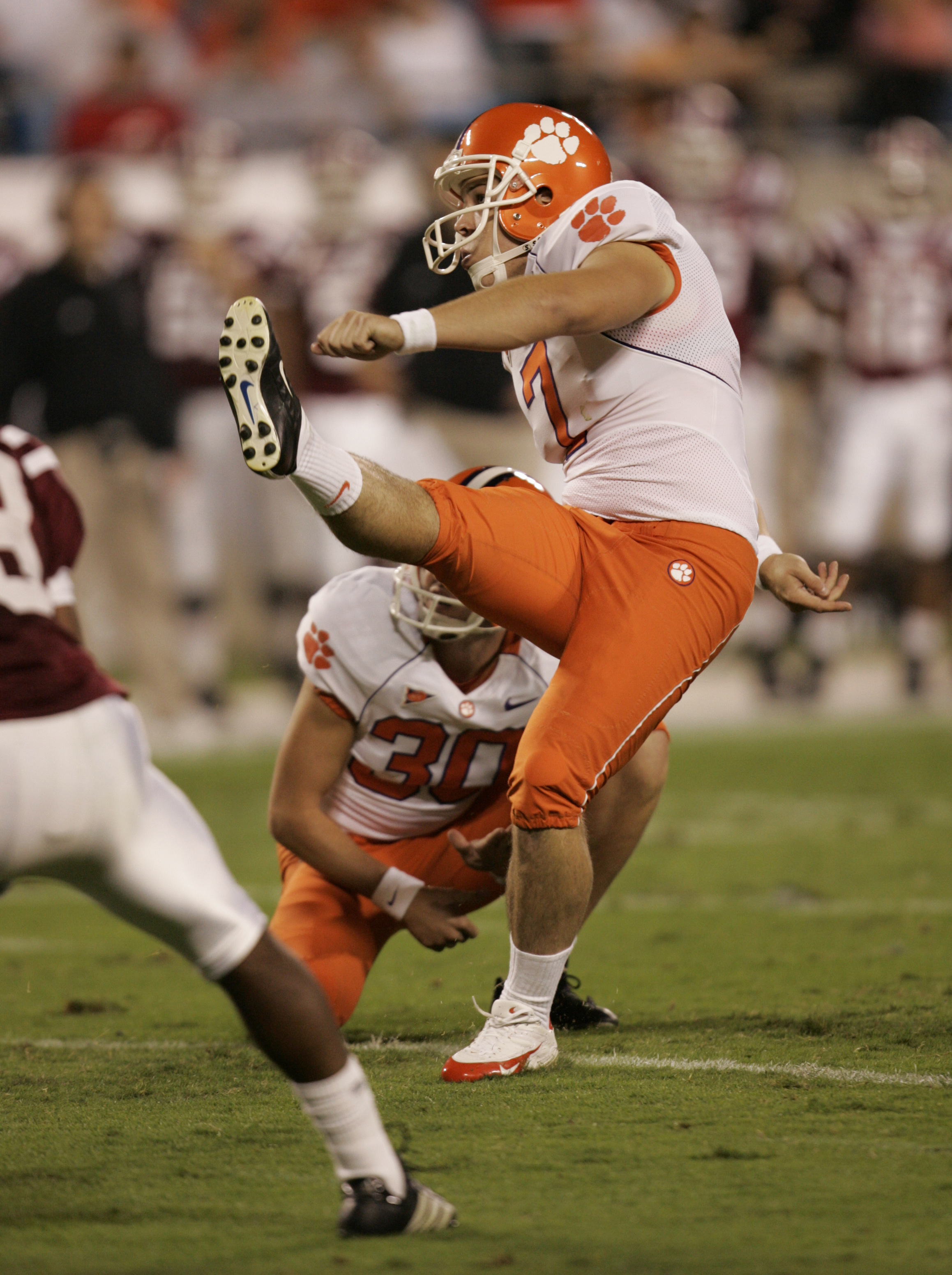 Jad Dean kicks for Clemson University in 2006.